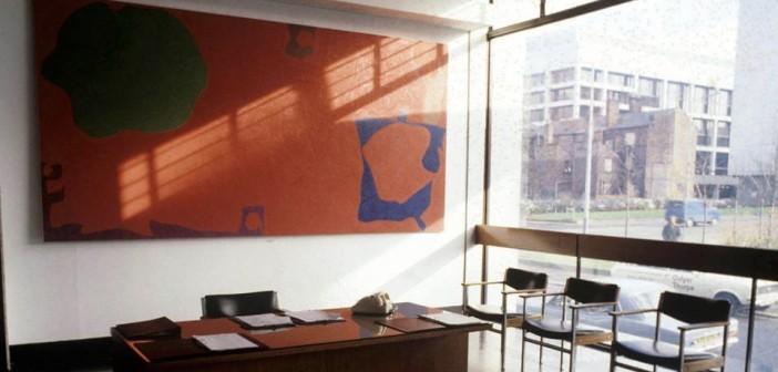 Desk with large piece of art work behind copy