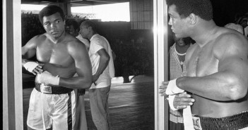 FILE - In this Sept. 29, 1975 file photo, Muhammad Ali, world heavyweight boxing champion, looks at himself in a mirror during a training session in Manila, Philippines before his fight against Joe Frazier.  Ali, the magnificent heavyweight champion whose fast fists and irrepressible personality transcended sports and captivated the world, has died according to a statement released by his family Friday, June 3, 2016. He was 74.  (AP Photo/File)